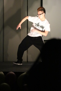 Sophomore Kun Qian showed off some impressive hip-hop moves synchronized to music beats. (Photo by Hamis Al-Sharif)