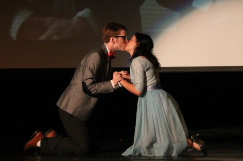 """Peter Gernon and Kenadi Silcox, as Brad Majors and Janet Weiss, share a kiss at the end of the musical number """"Dammit Janet."""" Photo Credit: Danielle Maingot/FOGHORN"""
