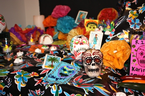 An intricate Dia De Los Muertos altar set up among the Thacher Gallery exhibit to honor the passing of loved ones courtesy of Thatcher Gallery