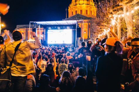 A contingent of loyal Giants fans cheer on their team at the Civic Center during Game Seven of the World Series. Daniel Berberi / Foghorn