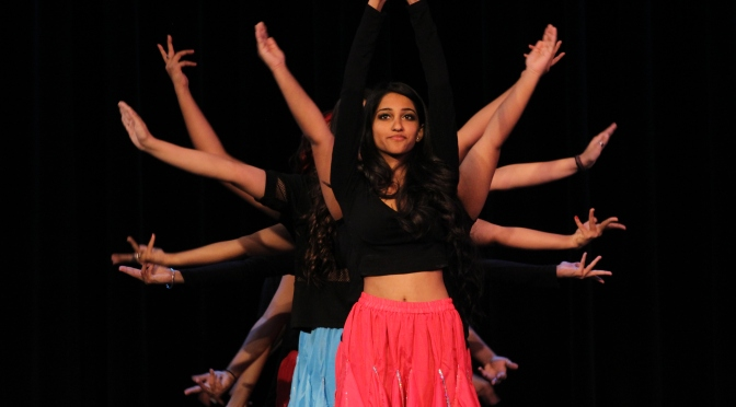 Showcasing a range of contemporary to traditional Indian dances, Deepa Mistry takes center stage as hands fan out behind her during a portion of the Indian Student Organization's performance. COLLEEN BARRETT/foghorn