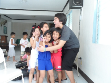 Junior Chris Lamelas plays with children during his semester abroad at Casa Bayanihan during fall 2013. PHOTO COURTESY OF UNIVERSITY MINISTRY