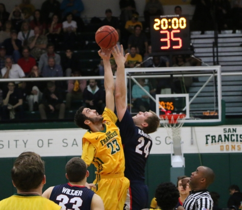 Starting forward Mark Tollefsen goes up for the jump ball to start off the game. John Holton/Foghorn