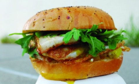 """The Bacon Bacon Truck's """"The Belly"""" complete with fried egg and arugula."""