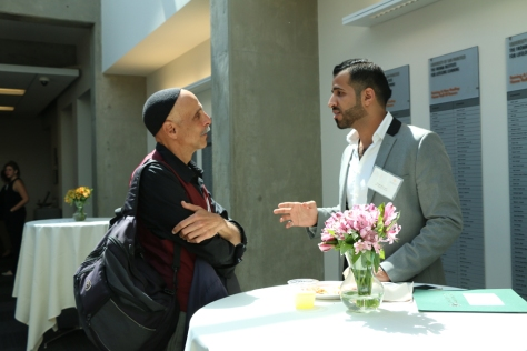 USF Professor Andrew Ramer discusses interreligious relations with an attendee during the lunch and prayer session.  Photo courtesy of Racquel Gonzales/Foghorn