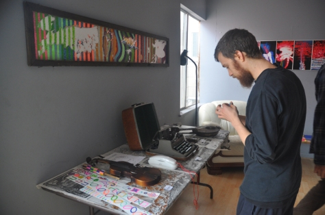 Danny Berliner, manager of the Honey Hive, showcasing some of Alban's interactive pieces.